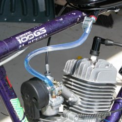 Powerking Engine and blue fuel flowing into tube