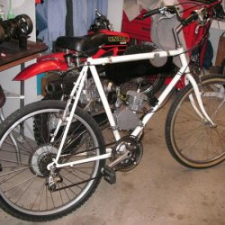 This is my old Pacific, with hanging tank. I like this bike it is like my knock around bike. Found abandon in the park, added the engine and a little