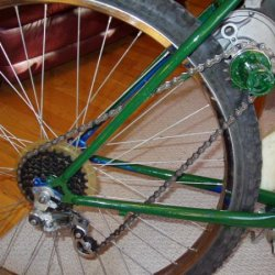 I kept the derailer for chain tension purposes and welded it into the first gear position so I could remove the cable. the gear ratio from the output
