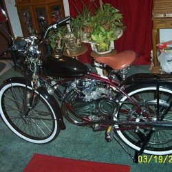 This is my 1955 Schwin Deluxe Cruiser,converted it to a Whizzer last winter. Has a HOT Quento mtr.