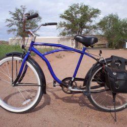 This is my electric cruiser 24v. I keep a 12v in each bag. Top end is 15mph
