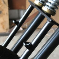 close up of brake tube guides on front springer forks