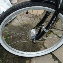 Sturmey Archer X-FDD dynamo brake hub.  I have changed the brake lever strap so it does not look like this.  Love it.