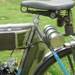 Under the seat is a battery can that would have housed dry cell batteries for the ignition system. Most bikes had a triangular or square can that held