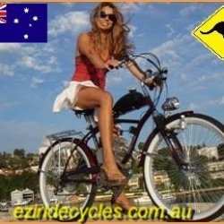 Suzy on the red beach cruiser from EziRide Cycles Australia.