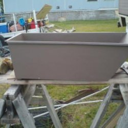 This is a pic of the newly painted sidecar tub. It's a textured medium desert tan color. The bike will be painted to match