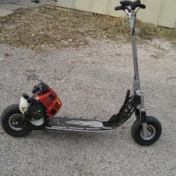 I got really bored so mounted a spare 31cc Huasheng 4 cycle engine on my Bladez scooter which originally had a 35cc Tanaka and is extremely loud. This