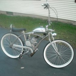 66 cc flying horse, ape hangers, chrome headlight,springer front end, black bannana seat, and speedo.