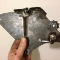 Make a sprocket side engine guard with a chain tensioner