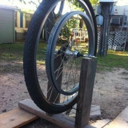 DIY bike stand used for truing a re-spoked wheel