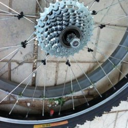 after 4500 miles, it's time to replace all 18 spokes on the drive ring side of the standard MTB wheel. 3 step technique was used. professional strengt