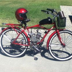 shiny red huffy with basket and matching red helmet for the lady