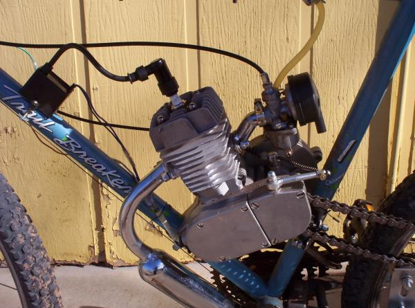 50cc motor from Powerking on ebay. It came with 44 tooth sprocket. Top speed 25mph.