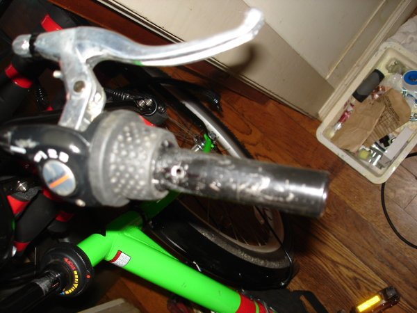 Drilled a hole in the Right Handlebar to accept the pin on the Throttle.