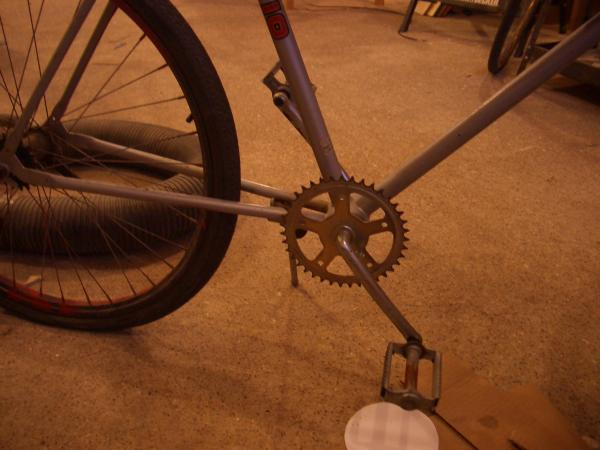 I removed the chain guard and large chain ring retaining the smaller ring for crfeating a lower gear.