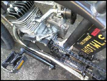 View of rear offset motor mount with new chopper exhaust pipe and using an offset intake from a CNS carb.